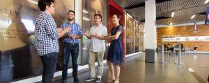 4 people having conversation in building