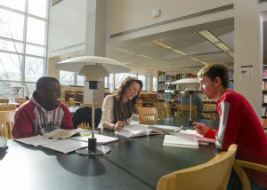 Students gathering in a library to socialize as well as study