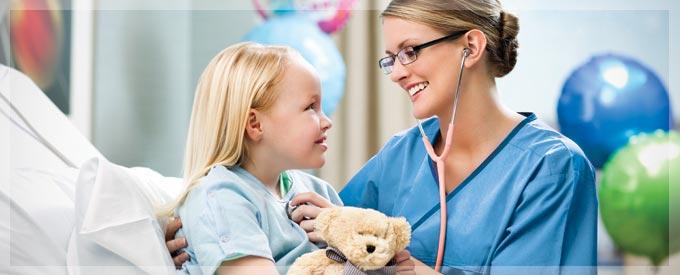 A nurse checking a child