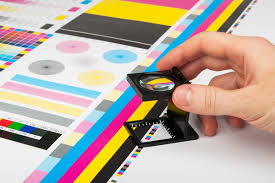 Printing instructor checking colors using a lens