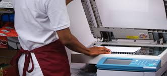 A close-up picture of a student operating a printer