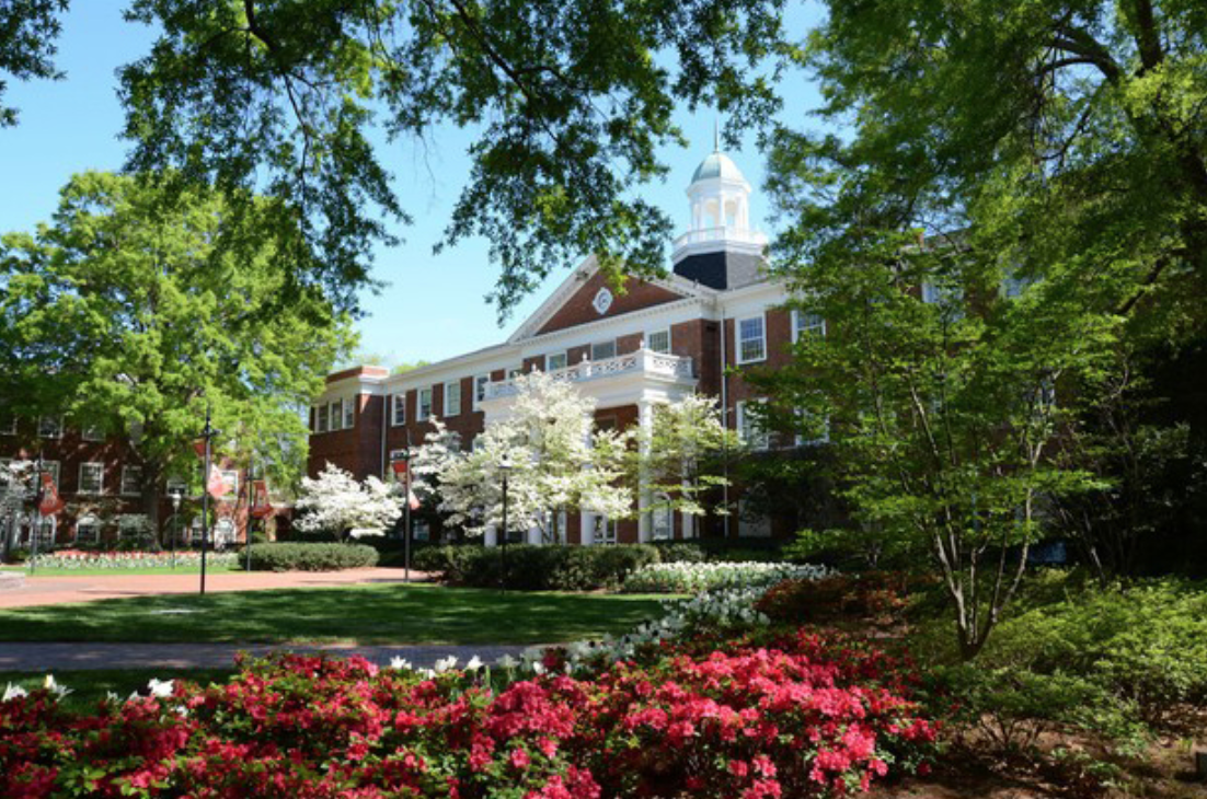 Flowers in front of main building at Elon University