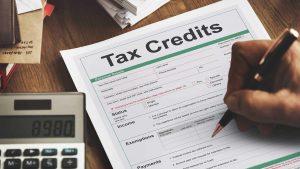 A man filling a tax credit form