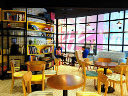 Few students in a library coffee shop
