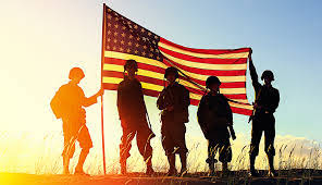 a picture of veterans with the American flag.
