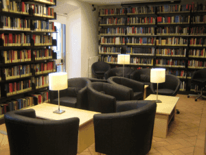 a study room with book shelves