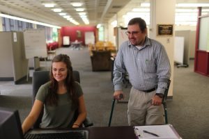 Two people working at the Wollock Learning Commons
