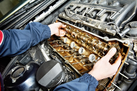 A mechanical engineer fixing a car engine