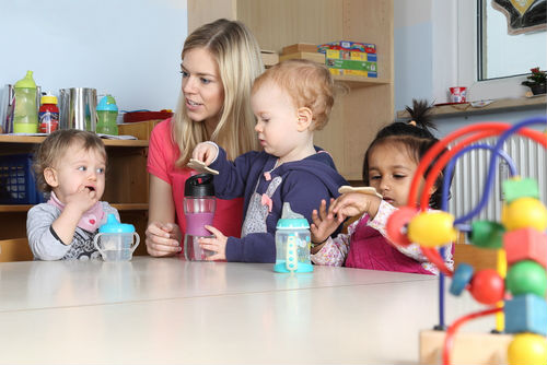 A child care specialists teaching children