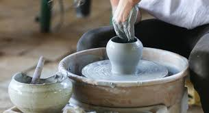 This image shows a student making a piece of ceramic art.