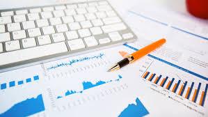 Pens, computer, and charts