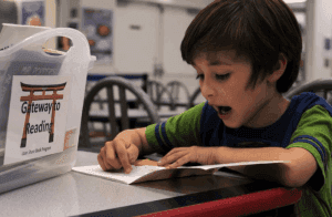 elementary student reading book