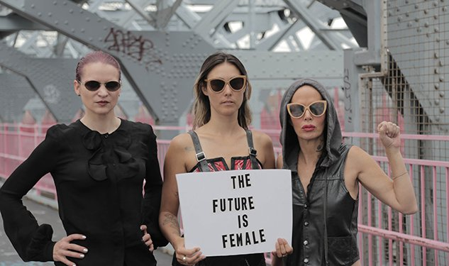 a group of feminist holding a sign