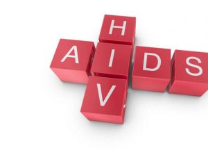 the words HIV and AIDS spelled out using scrabble pieces