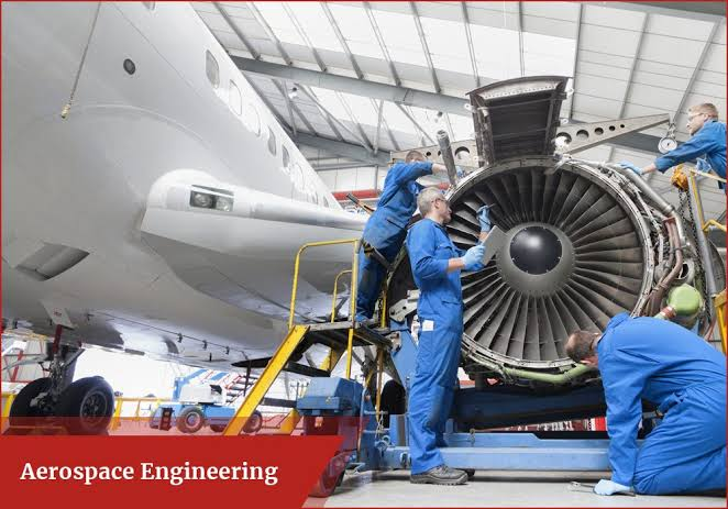 Aerospace engineers working on an aircraft
