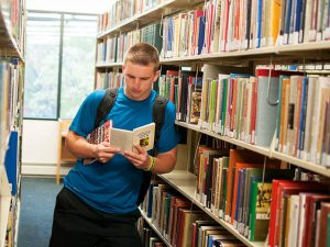 A student reading at Jackson Library