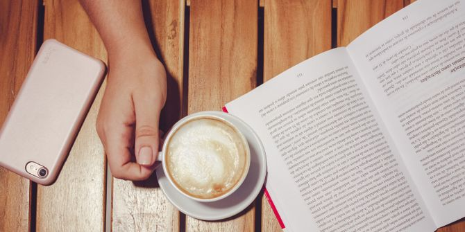 A student studying or reading with a latte