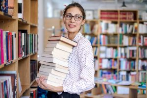 a librarian holding a stack of books