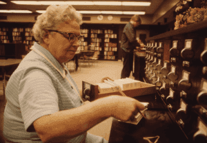librarian checking on library catalog