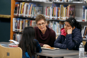 librarian helps students