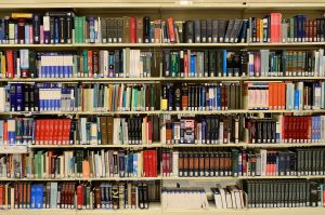 Different types of books on a library shelf