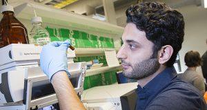 A Biochemist looking at a sample