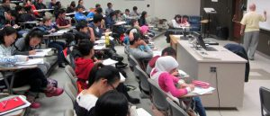 Mathematics students receiving lectures and taking notes