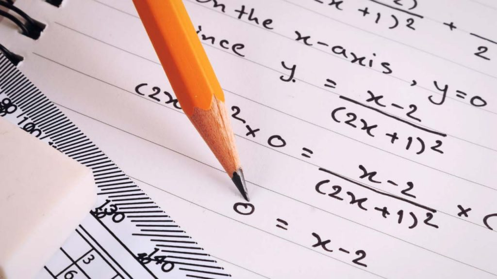 picture of pencil on paper, writing math equations
