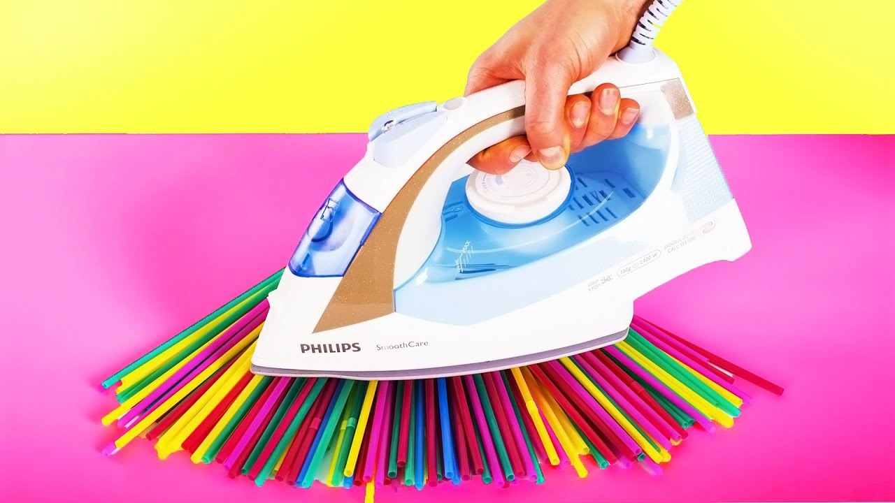 Someone holding a steam iron on top of straws