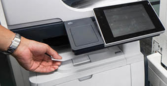 A person using the photocopier