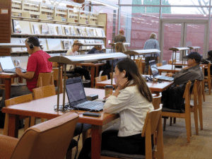 student using laptop in the library