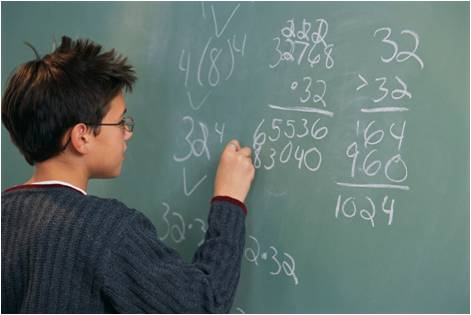 a student doing math on a chalk board