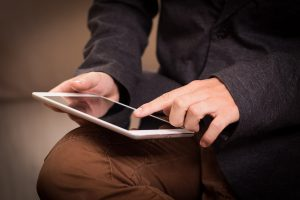 A person accessing information on an iPad