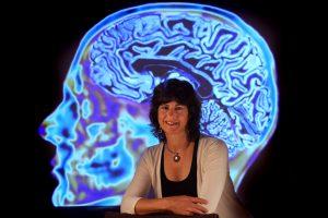 A neurologist behind a structure of a brain