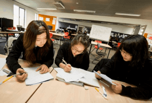 three female students reviewing for exams