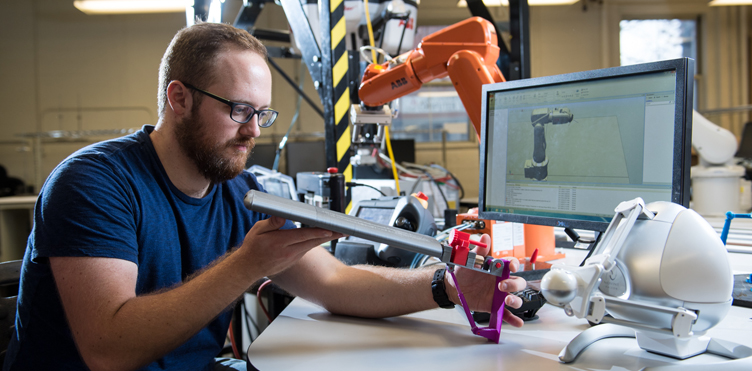 Mechanical Engineering majors students developing a robot in university of New Orleans