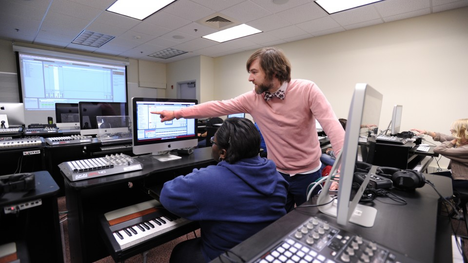 Sound engineers working in a music studio