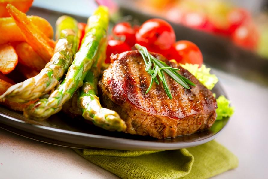Chicken grilled serving on plate with asparagus