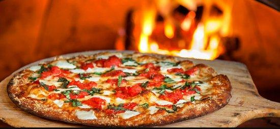 Delicious pizza serving by Global Village