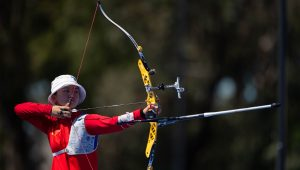 An Archer pointing at a target