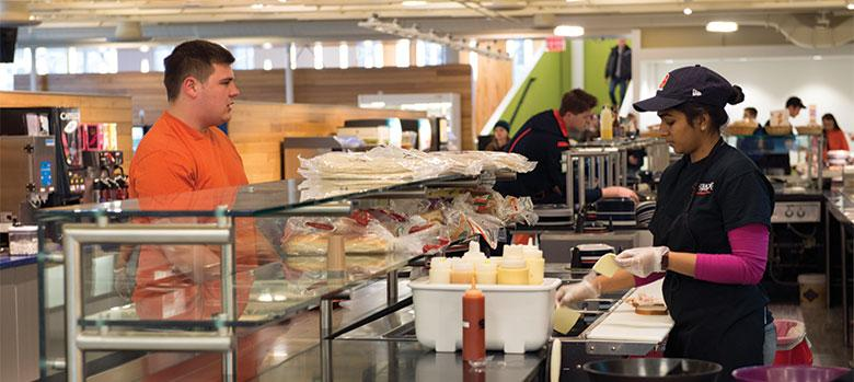 Student ordering food at Deli counter