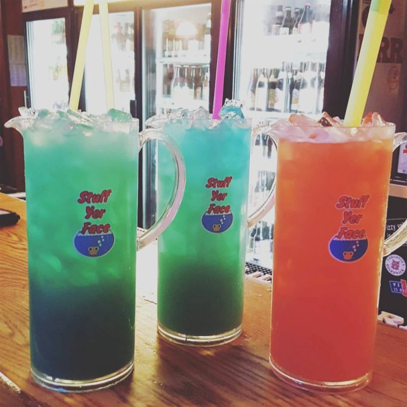 an array of fish bowl drinks