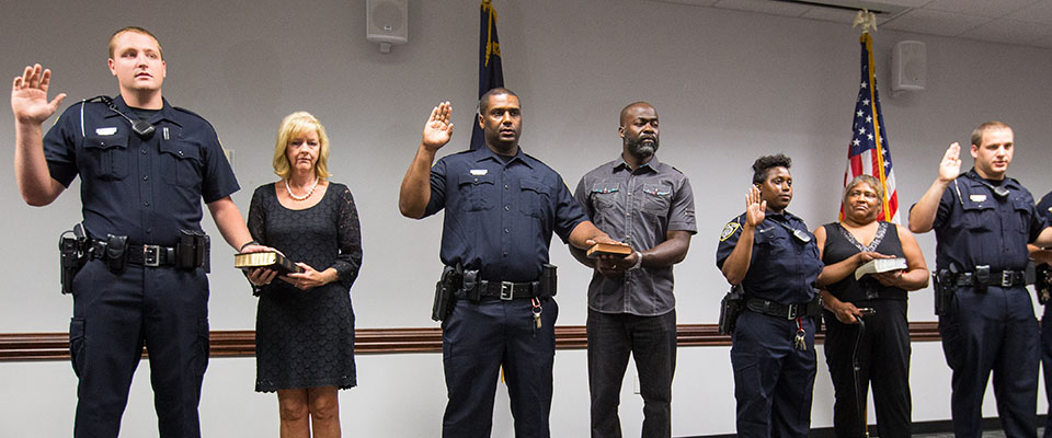 This image shows new officers getting sworn in on campus.