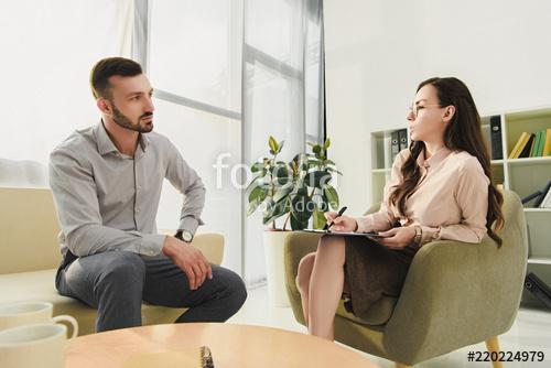 A man and women sitting on chairs