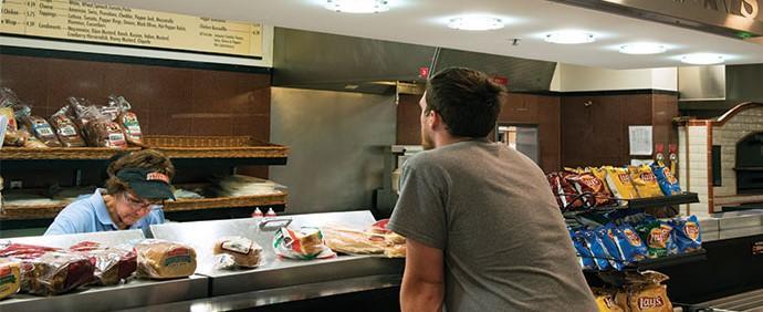 Student placing order at Quesadillas and Rice Bowls