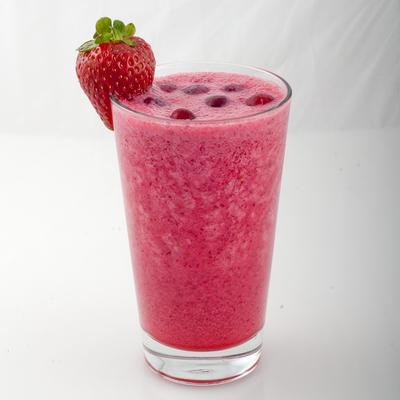 A healthy serving of smoothie in a glass