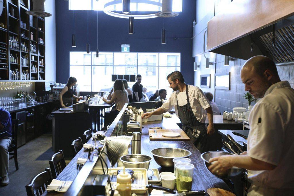 Chefs preparing dishes at Bundok