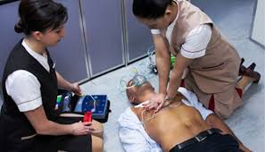 Two nurses giving an immediate first aid medical care to a patient