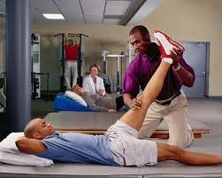 Doctor help a person in his Physical Therapy