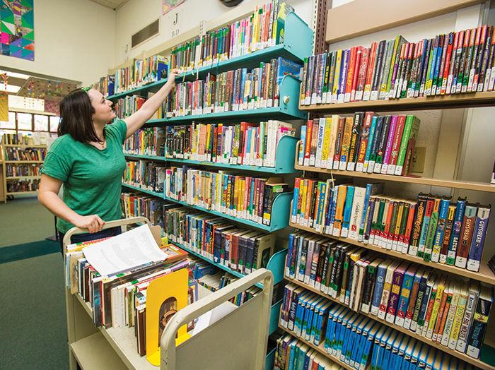 A librarian shelving books